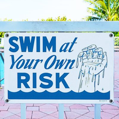 40318   12'' x 18'' Swim at Your Own Risk Sign - Lifestyle